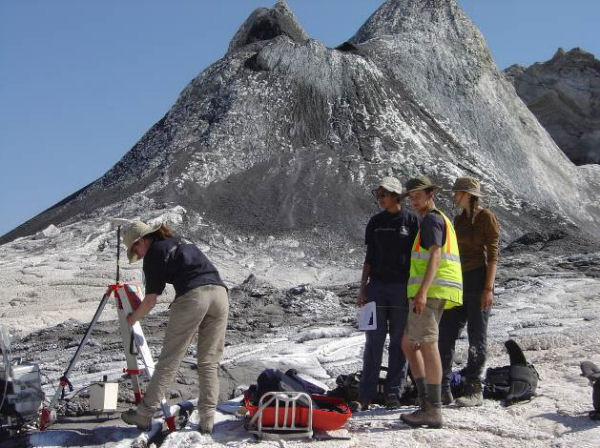 Setting up the GPS receiver in the crater of Ol Doinyo Lengai.