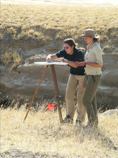 Camilla and Megan plane table surveying around the Keremasi base camp.
