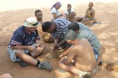Kalahari - Our Cook Charles Shows The Bushmen How To Make Fire